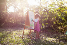 A Pre-school Girl Painting At ...