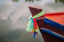 Colourful Rope Tight Around Head Of Wooden Fishing Boat In Tropical Canal Thailand