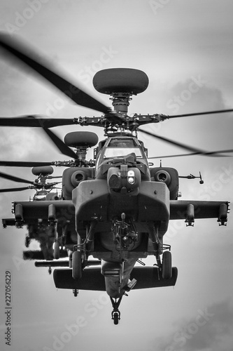 A stack of three Apache attack helicopters head-on Wallpaper Mural