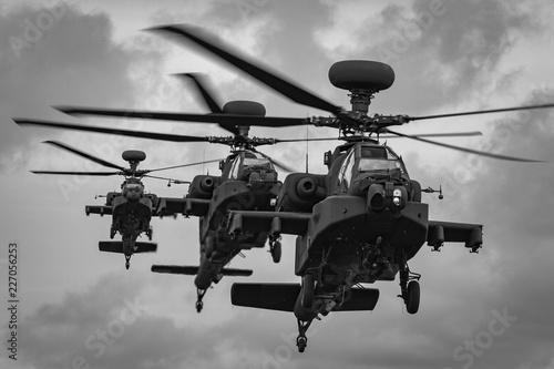 A line of three WAH-64 Apache Longbow attack helicopters coming into land, RAF S Canvas Print