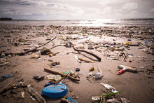 Beach Polluted With Plastics And Waste
