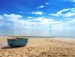 Fishing boat on the sandy seashore