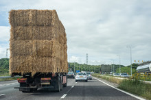 Truck Transporting Hay Bales On A Highway In The UK