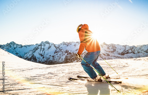 Fotografie, Obraz  Professional skier athlete skiing at sunset on top of french alps ski resort - W