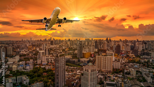 Airplane flying over cityscape 2