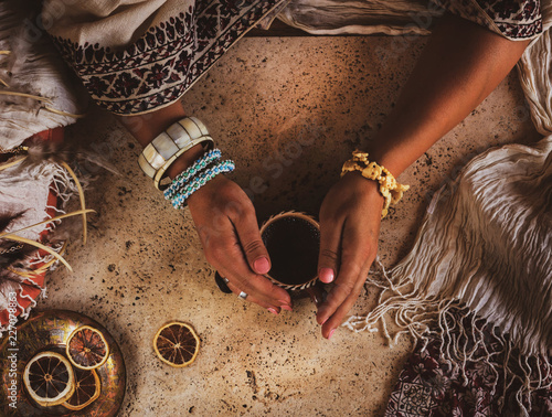 Fond de hotte en verre imprimé Style Boho Beautiful female hands holding a cup of coffee. Photo in oriental style. Jewelry boho.
