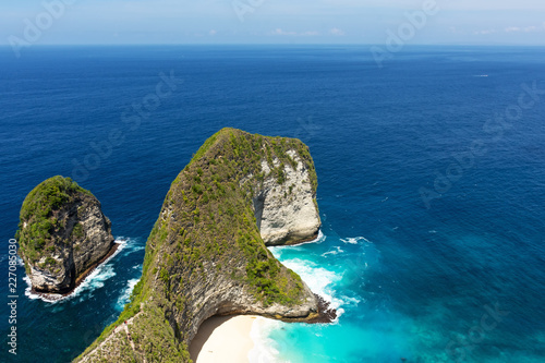 Fotografie, Obraz Beautiful view of Kelingking beach, it's a hidden beach in the village of Bunga Mekar, on the southwestern coast of Nusa Penida island, Bali, Indonesia