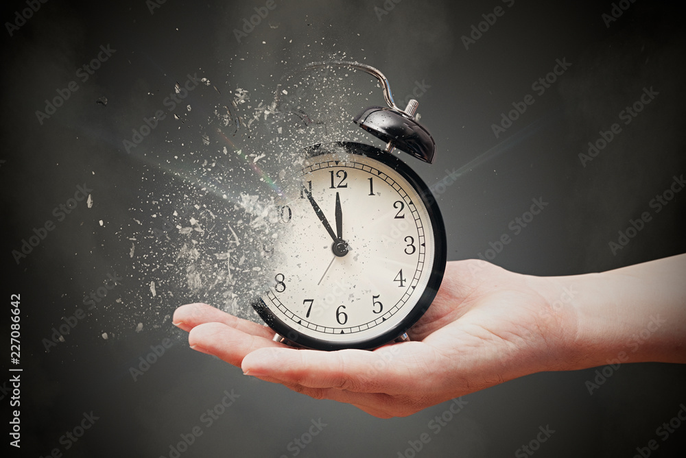 Concept of passing away, the clock breaks down into pieces