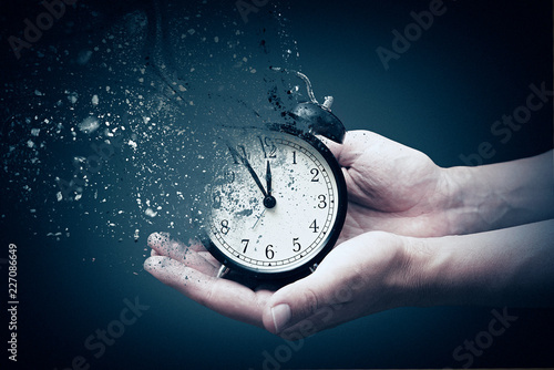 Concept of passing away, the clock breaks down into pieces Wallpaper Mural