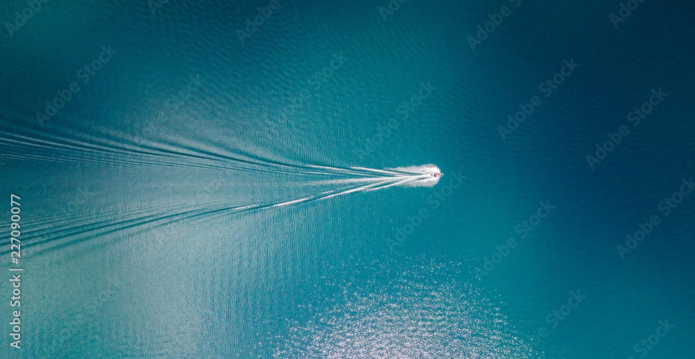 Fototapety, obrazy: Drone view of a boat sailing across the blue clear waters of lake Tahoe California