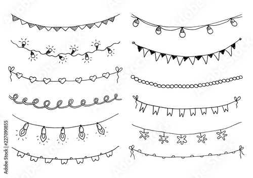 Fotografia  Set of hand drawn sketch garlands with flags and light bulbs.