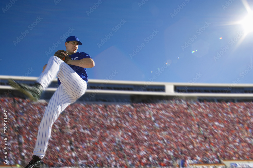 Fototapety, obrazy: Baseball pitcher in crowded stadium throwing ball during game
