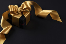 Beautiful Minimalistic Multi Purpose Composition With Gift Box Wrapped And Tied With Satin Ribbon. Holiday Present In Festive Wrapping. Background, Copy Space, Close Up, Top View, Flat Lay.