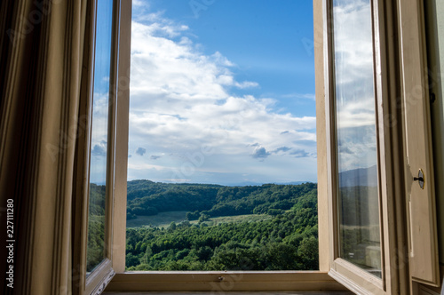 Panoramic view of the rolling hills of Chianti through a window in early morning Fototapeta