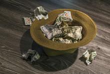 Throwing $100 Bills Into Hat