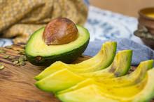 Ripe Avocado Pieces On Wooden ...