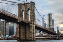 Low Angle View Of Brooklyn Bridge Over East River Against Modern Buildings In City