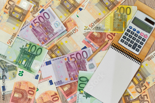 Fotografía  Euro, European money, various denominations with a calculator and a notebook in which you can write something
