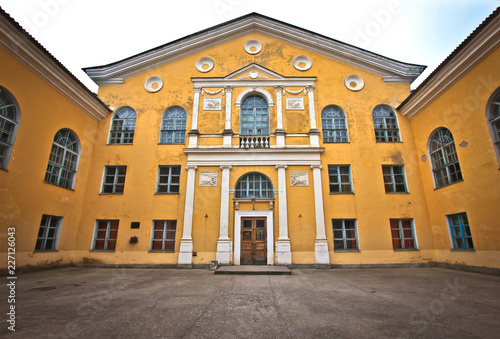 Foto op Plexiglas Theater Empire style of facade of the yellow building - House of Culture