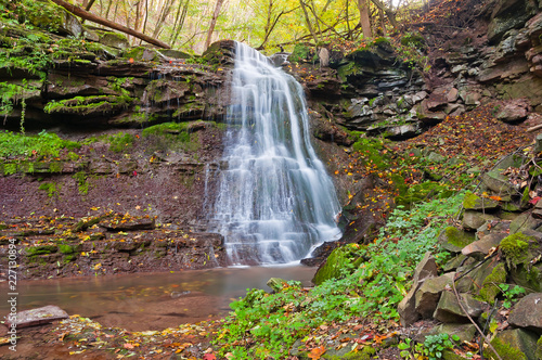 Beautiful waterfall on a mountain stream in the woods