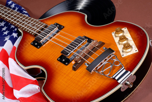 Photo  Sixties Violin Shaped Electric Guitar With LP Album Record