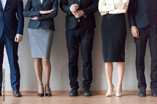 Cuadros en Lienzo Legs of diverse work team pose for corporate photoshoot or make picture, job applicants in suits standing in row, waiting for recruiting talk or interview results