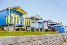 Quaint Wooden Beach Huts In A ...
