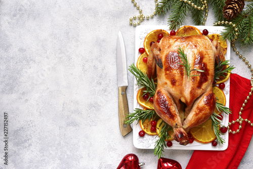 Roasted chicken with oranges , rosemary and cranberries.Top view with copy space.