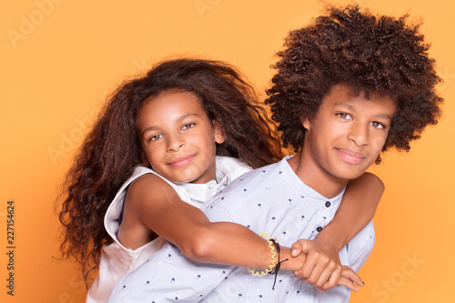 Happy brother and sister with afro hairstyle