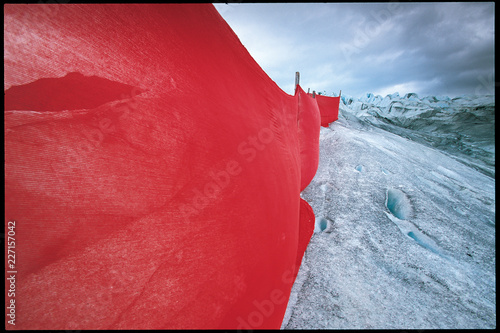 Red fabric on a snowy mountain