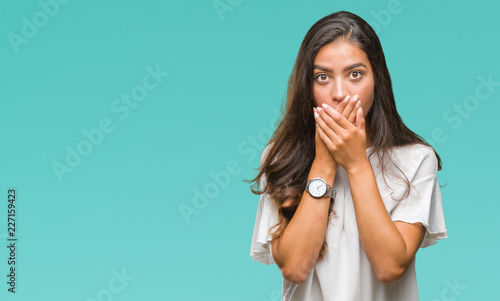 Fotografie, Obraz  Young beautiful arab woman over isolated background shocked covering mouth with hands for mistake
