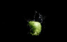 Green Apple With Splashing Water Drops