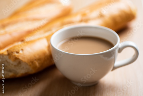 Valokuva  Cup of coffee and baguette french bread