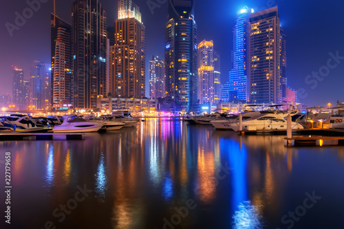 Spoed Foto op Canvas Stad gebouw Beautiful view to Dubai Marina, UAE. Luxury yachts at pier. Long exposure time lapse effect at night
