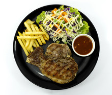 Steak Kurobuta Pork Chop Black Pepper Sauce In Plate On White Background. Props Decoration French Fries, Green Salad, Top View With Copy Space For Your Text..