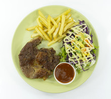 Steak Kurobuta Pork Chop Black Pepper Sauce In Plate On White Background. Props Decoration French Fries, Green Salad,Top View.