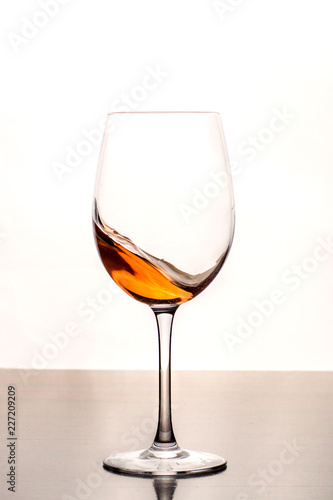 Fotobehang Alcohol White wine splashes in wine glass