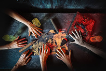 Top View Of Hands In Quest Game. Solving A Puzzle During Riddle. Escape The Room Game Concept