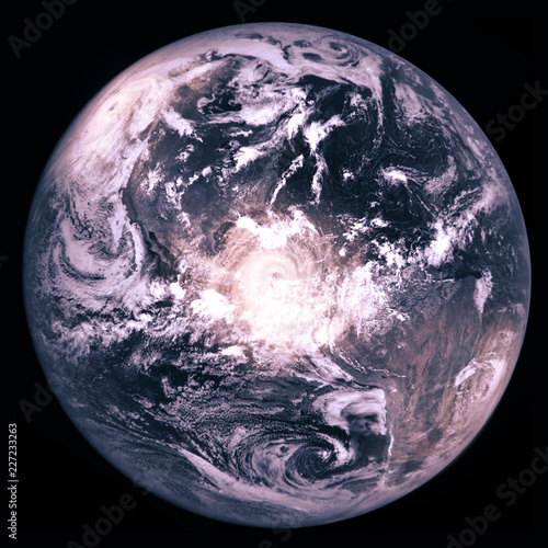 Earth planet with three huge hurricanes, collage image, view on the Americas from the Moon. Isolated on black background. Elements of this image furnished by NASA.