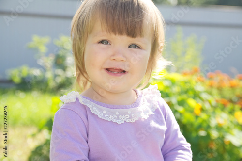 Cute baby girl happy smiling portrait. Adorable emotional child outdoor in park