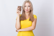Blonde woman holding coffee cup in her hands