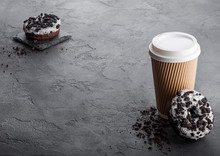 Cardboard Coffee Cup With Black Cookies Doughnuts On Black Stone Kitchen Table Background. Cafe Drink And Snack. Space For Text