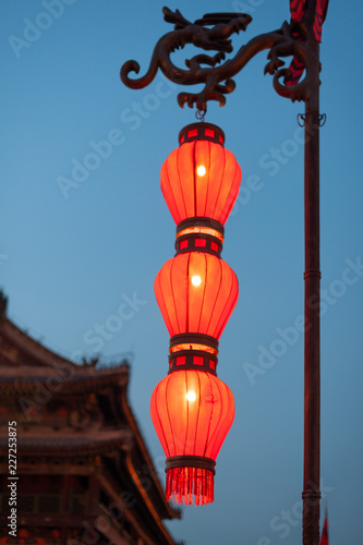 Illuminated red chinese lanterns on the fortified wall at night in Xi'an, China