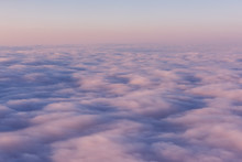 A Field Of Pink Clouds At Sunset. View From Above. Sky Feather Beds.