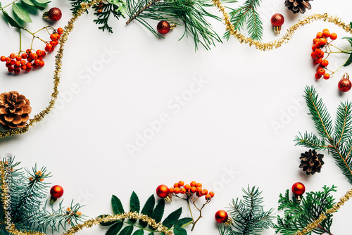 Stampa su Tela flat lay with festive arrangement of pine tree branches, common sea buckthorn an