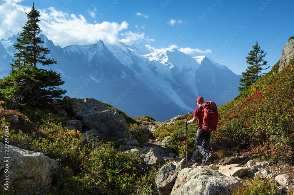 Fototapety, obrazy: A man hiking on the famous Tour du Mont Blanc near Chamonix, France.