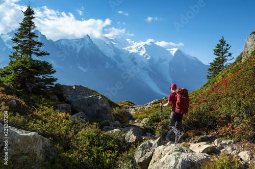 Fototapeta A man hiking on the famous Tour du Mont Blanc near Chamonix, France. obraz