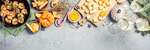 Christmas dinner party table, holiday vegeterian food concept background, top view, flat lay with copy space. Banner