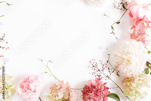 Festive white pink flower English rose and hydrangea composition on the white background. Banner. Overhead top view, flat lay. Copy space. Birthday, Mother's, Valentines, Women's, Wedding Day concept.