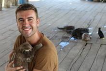Lovely Sloth Hugging A Man